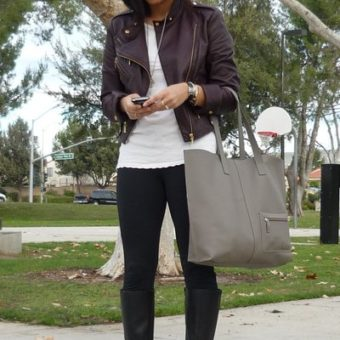 brown leather jacket and black boots